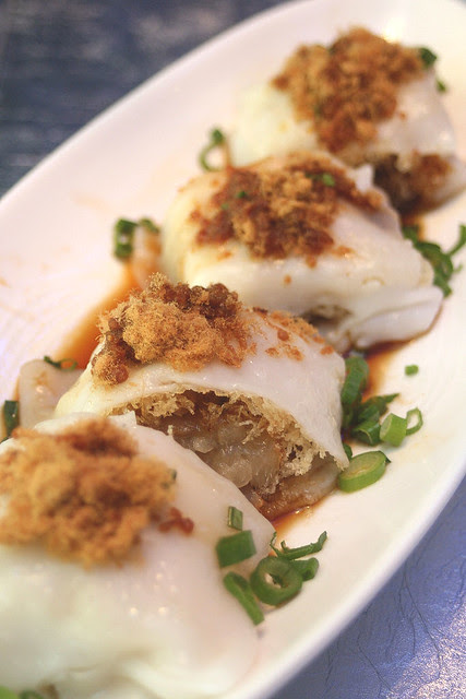 Dinosaur Rice Roll - giant cheong fun with crispy batter and popiah-like turnip filling, topped with meat floss