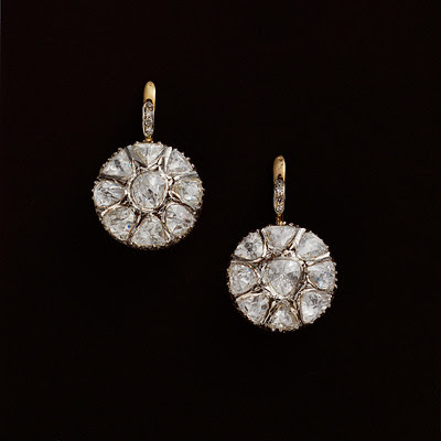 04 A pair of silver, gold and diamond wheel earclips