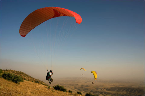 Ziad Abdulsattar lifts his feet when taking off with a parachute  with Falcon Aviation Club near Mosul.