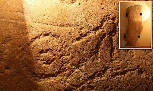 Iron Age stone slab engraved in ancient symbols baffles experts