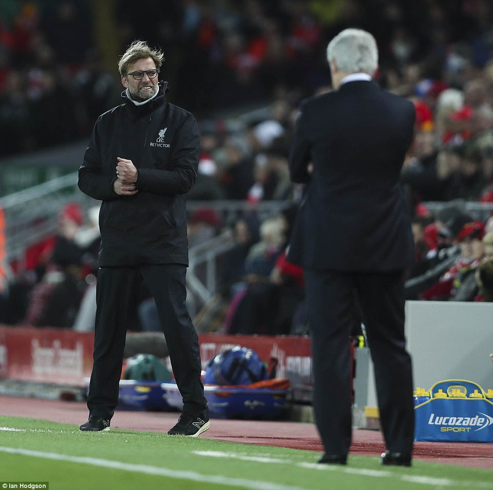 Liverpool manager Jurgen Klopp (left) watches on with a grimace on his face during Tuesday night's game against Stoke