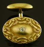 Elegant diamond and scroll cufflinks. (J9327)
