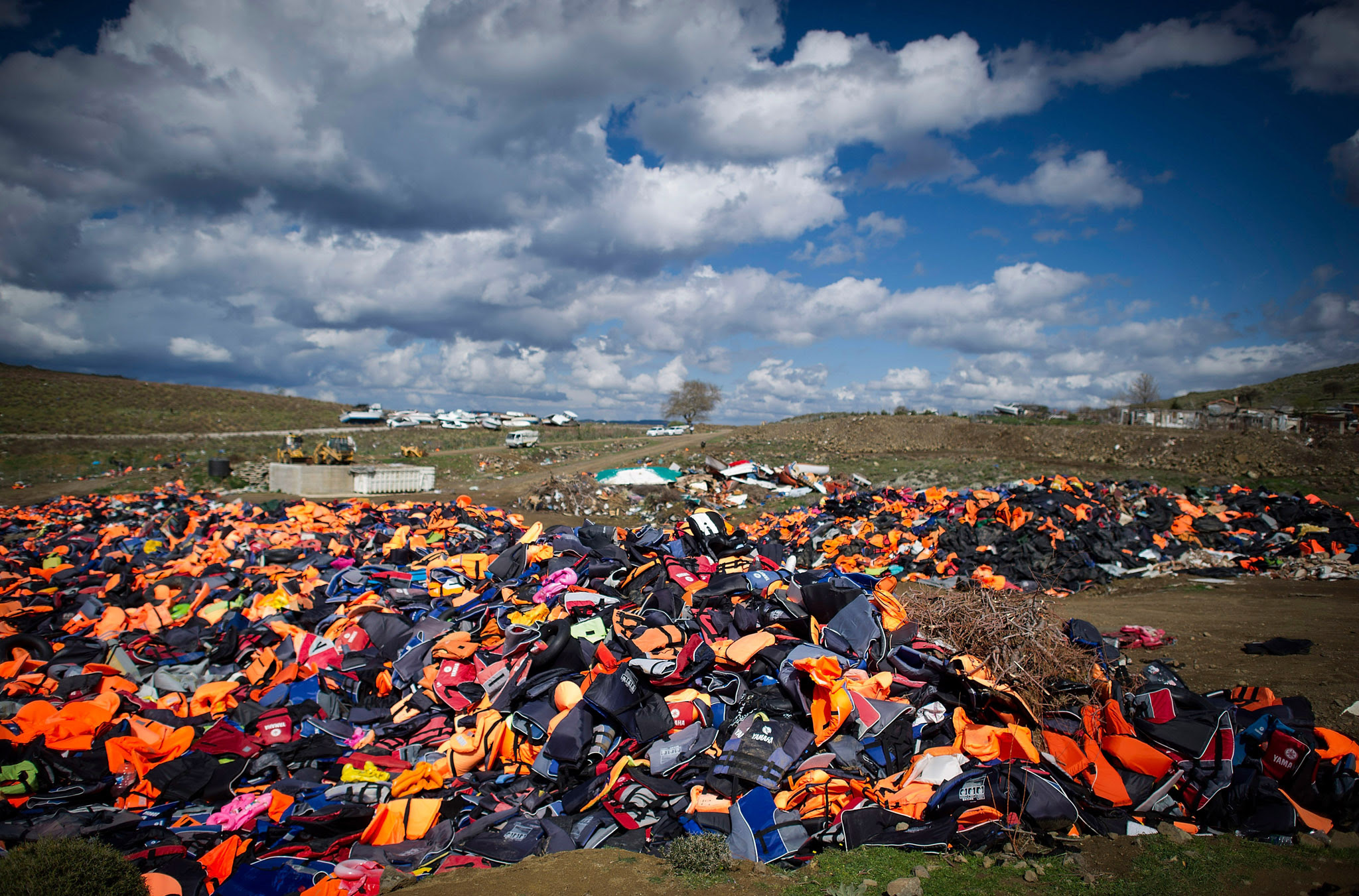 Greek Island Of Lesbos On The Frontline Of the Migrant Crisis...MITHYMNA, GREECE - MARCH 10:  Hundreds of used life vests lie on a makeshift rubbish dump hidden in the hills above the town on March 10, 2016 in Mithymna, Greece. Local authorities start to clean the beaches from life vests and destroyed dinghies, used by refugees and migrants after crossing the sea from Turkey to Lesbos. The village of Mithymna is the northest town of the Island of Lesbos and located 75 kilometres north of the Capitol Mytilini. Migrants and refugees are still arriving on the shores of the Island of Lesbos, while Joined Forces of the Standing NATO (North Atlantic Treaty Organisation) Maritime Group 2 are patrolling the coast of the greek Island of Lesbos and the turkish coast. Turkey has announced on Monday to take back illegal migrants from Syria and to exchange those with legal migrants.  (Photo by Alexander Koerner/Getty Images)