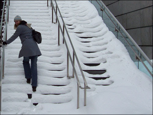 On snowy Montreal stairs