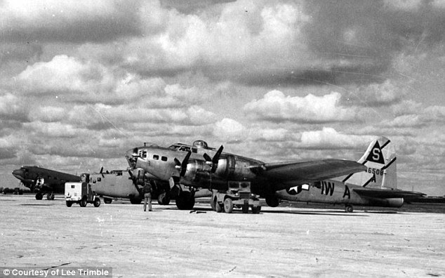 Improvised: The cover Captain Robert Trimble used was that his unit was helping salvage downed US planes. He was based at Poltava, in the Ukraine, where American air power including (front) a B-17 Flying Fortress, (middle) a B-24 Liberator and (rear) a Douglas C-47 Skytrain are seen