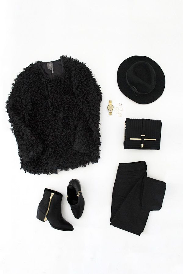 Le Fashion Blog All Black Budget Friendly Winter Style Black Faux Fur Coat Hat Gold Watch Quilted Bag Black Jeans Metal Heel Ankle Boots Vince Camuto Macys