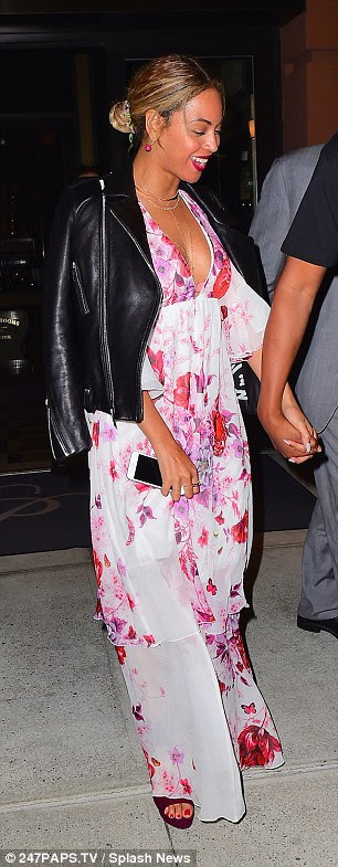 Feminine chic: The 34-year-old singer looked lovely in a floral maxi dress which showed off her cleavage