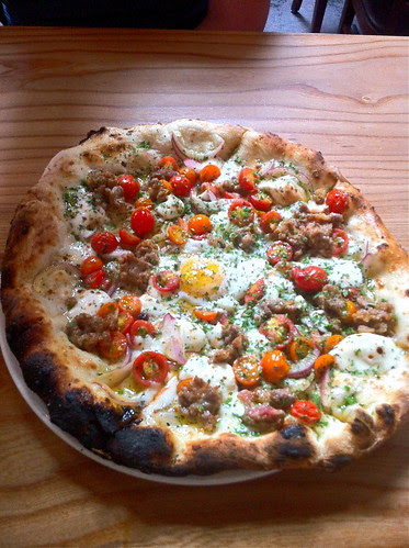 Breakfast pizza w cherry tomatoes and house-made sausage