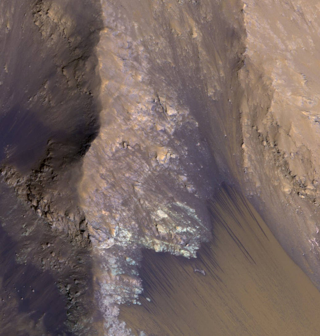 This July 21, 2015, image from the orbiter's HiRISE camera shows examples within Mars' Valles Marineris.