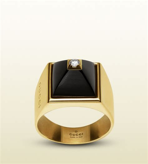 gucci ring in 18k in yellow gold, diamonds and black