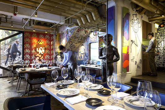 These 8 Restaurants Feature Amazing Art by the Likes of Banksy, Basquiat, and More | Architectural Digest