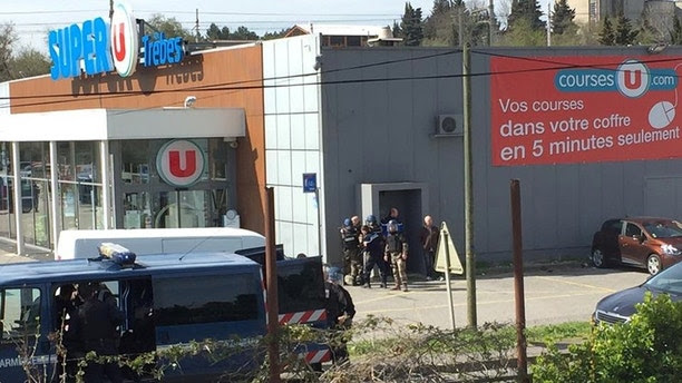 Police are seen at the scene of a hostage situation in a supermarket in Trebes, Aude, France March 23, 2018 in this picture obtained from a social media video. LA VIE A TREBES/via REUTERS ATTENTION EDITORS - THIS IMAGE WAS PROVIDED BY A THIRD PARTY. NO RESALES. NO ARCHIVES. MANDATORY CREDIT. - RC132A7340D0