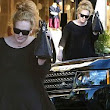 Adele hides behind her sunglasses... as she shops for even more baby things for 'Little Peanut'