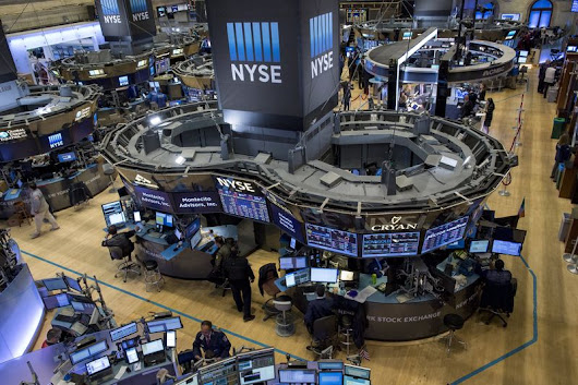 Wall St. points to lower open as investors eye data, earnings & Trump