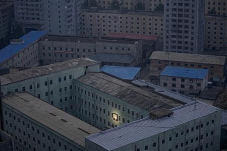 A picture of North Korea's founder Kim Il-sung decorates a building in Pyongyang early October 5, 2011 in this file photo. REUTERS-Damir Sagolj-Files
