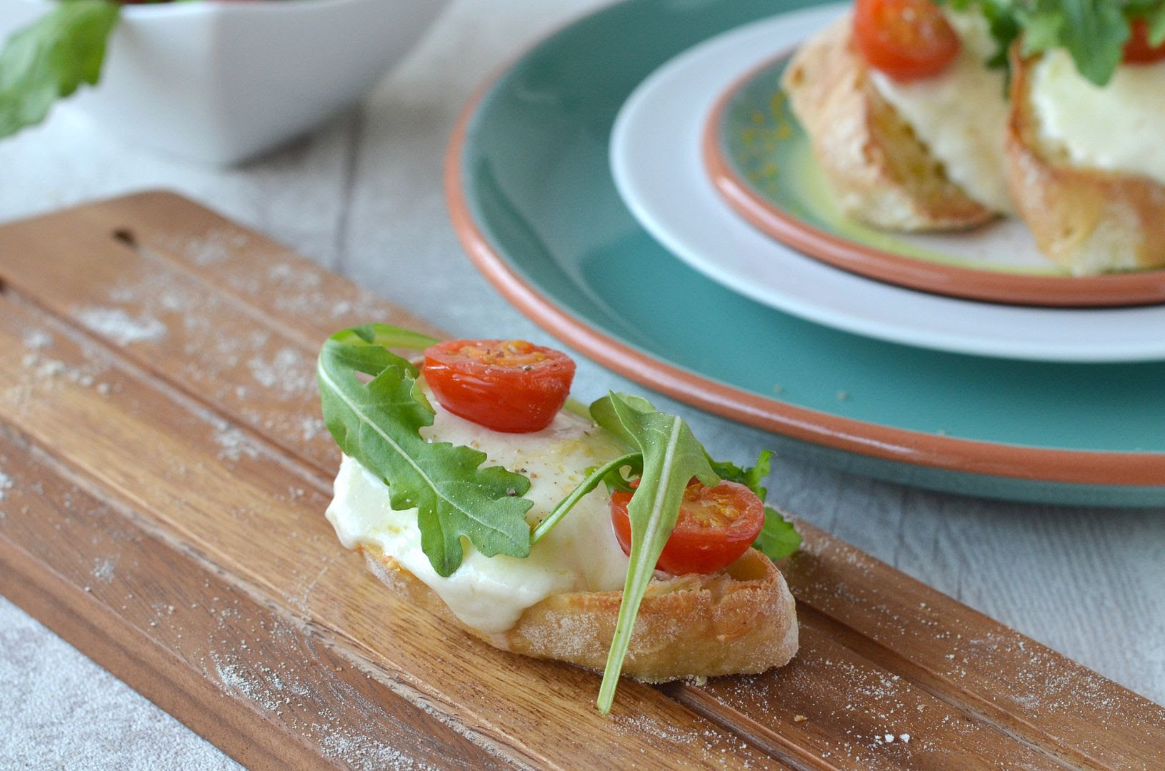 Home Baked Ciabatta topped with Mozzarella, Tomato & Rocket