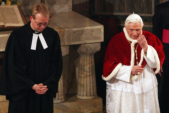 Pope Benedict XVI flanked by Rev. Jens-Martin Kruse prays prays during  his visit to the Lutheran Church of Rome on March 14, 2010 in Vatican City, Vatican. Benedict spoke about the importance of relationships between the different Christian churches.