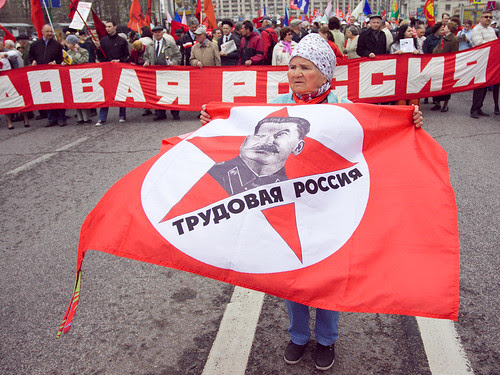 Communist supporters carry red flags and portraits of Soviet dictator Josef Stalin during a May Day rally marking International Workers' Day, or Labour Day, in Moscow May 1, 2011 by hegtor