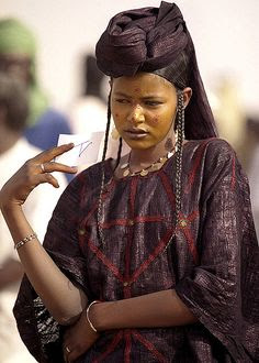 Wodaabe woman. Wodaabe are a small subgroup of the Fulani ethnic group, traditionally nomadic cattle-herders and traders with migrations stretching from southern Niger, through northern Nigeria, northeastern Cameroon, and the western region of the Central African Republic.