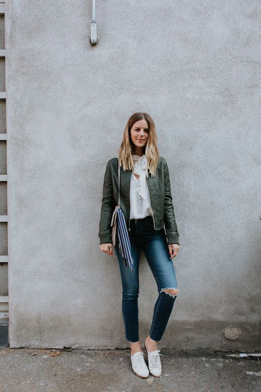 Le Fashion Blog Green Leather Jacket White Tie Neck Blouse Skinny Jeans White Shoe Via Take Aim