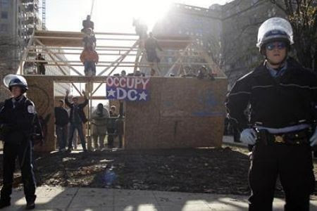 Washington, D.C. cops arrested some members of the Occupy DC movement. The authorities gave the excuse that a wooden structure had been at the camp. by Pan-African News Wire File Photos