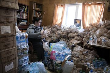 Bottled water is bagged up at the Mission of Hope shelter in Flint, Mich., for clients.
