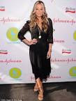 Molly Sims is a model mother as makes a stylish appearance with