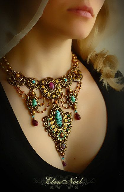 Indira by Elen Noel from Russia. The design feels ancient in a way. Love that faceted ruby at the center top.