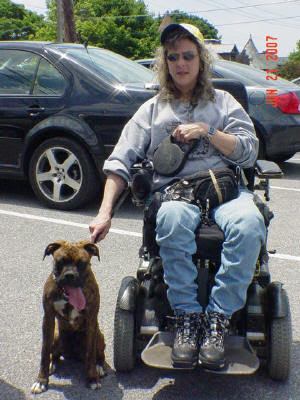 BUCHANANFPC PHOTO (BARBARA ROOK AND HER SERVICE DOG, THE BOXER)