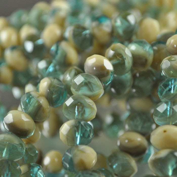 s35933 Firepolish - 8 x 6 mm Faceted Donut - Mermaid and Ivory (strand 25)