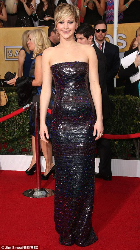 Working it! J-Law looked youthful and modern in her strapless shiny sequinned gown and black satin peep-toe platforms, which perfectly complemented her cropped blonde locks and perfectly-applied make-up