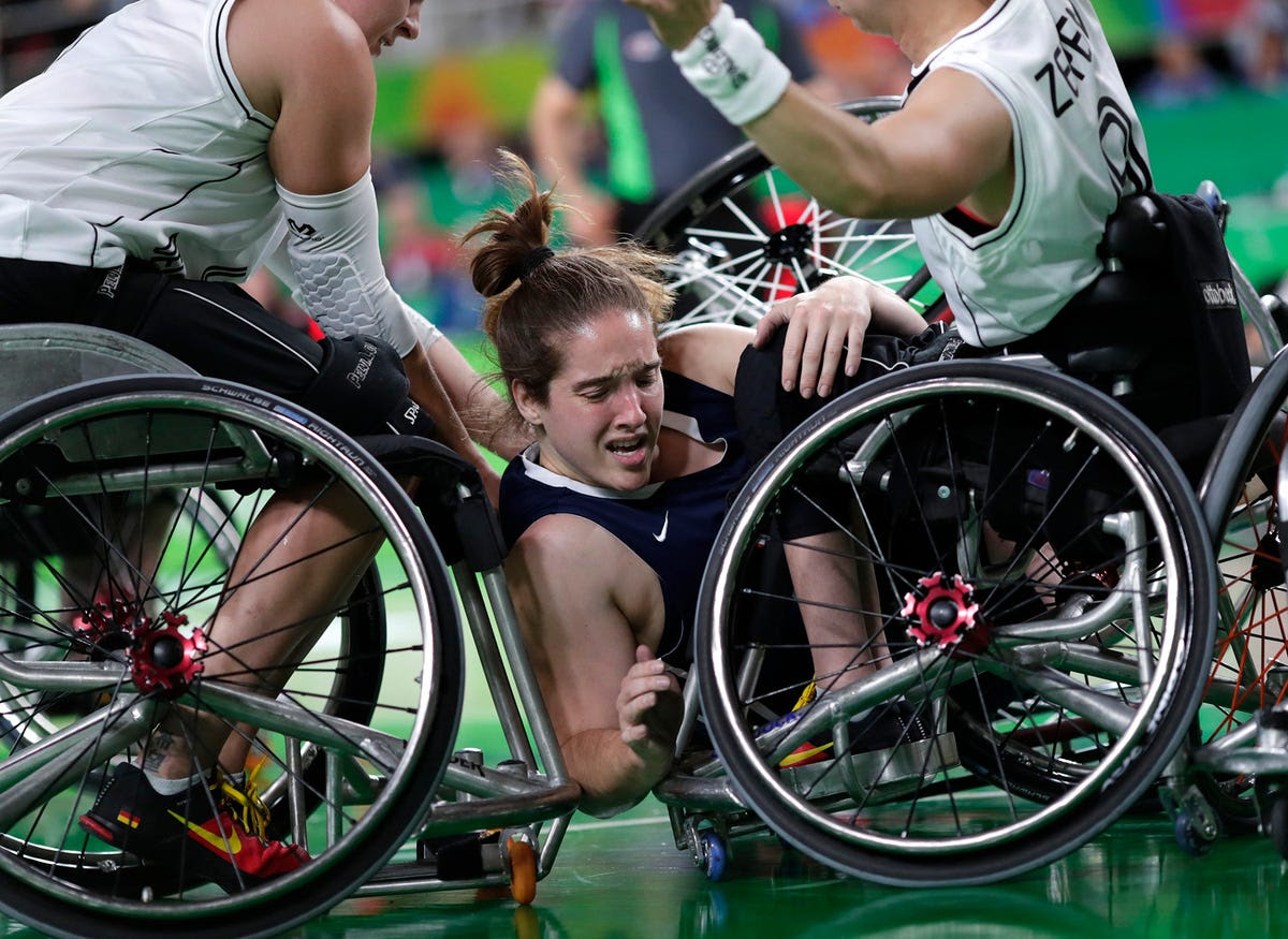 Rebecca Murray Team USA is sandwiched during a wheelchair basketball game.