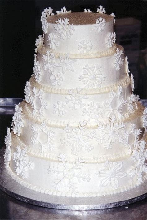 Snow white wedding cake with floral patterns