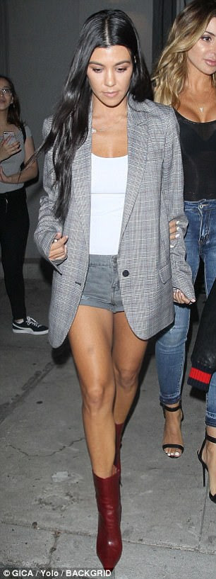 Hot to trot: The Keeping Up With The Kardashians star managed to set pulses racing in her casual look, formed of a formal blazer and denim shorts