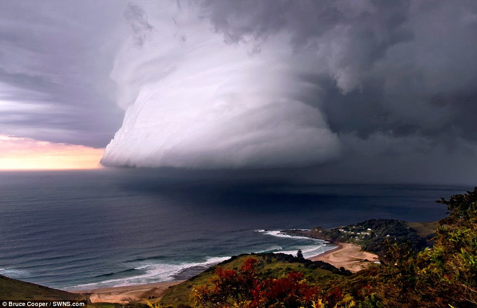 July: A squall line associated with a thunderstorm over Era Beach, south of Sydney by photographer Bruce Cooper