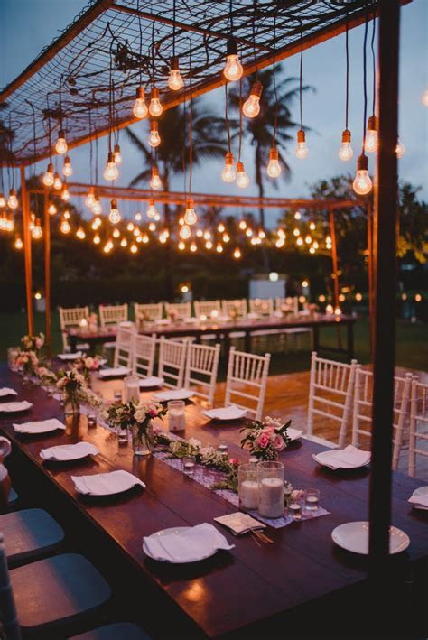 outdoor wedding table setting with hanging lights #bali #