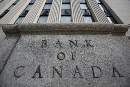 Bank of Canada holds rates but talks of more hikes, boosting C$
