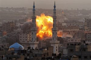 Smoke rises during an explosion from an Israeli strike in Gaza City, as the Hamas-ruled Strip was bombarded with nearly 200 airstrikes early on Saturday. The assault widened to include not just attacks on Gaza rocket operations but also the prime minister's headquarters, a police compound and a vast network of smuggling tunnels.