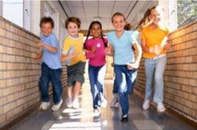 Kids running down a hallway