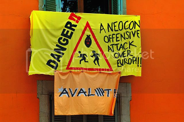 Neocon danger protest sign [enlarge]