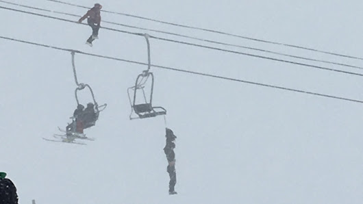 Man hanging unconscious by backpack on Arapahoe Basin chairlift is cut down by friend in harrowing rescue