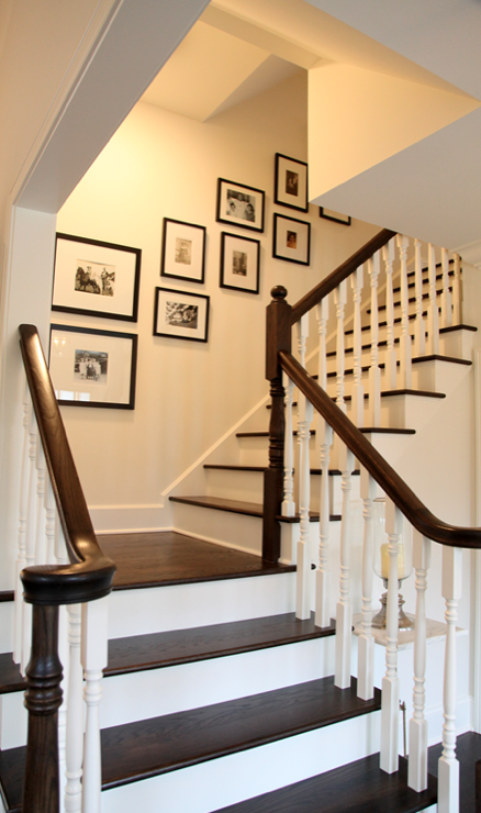Suzie: via COTE DE TEXAS  Gorgeous entry staircase with art gallery in black gallery frames.