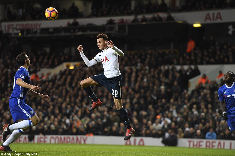 Tottenham midfielder Alli times his jump perfectly and prepares to head the ball in the build-up to the hosts' opener