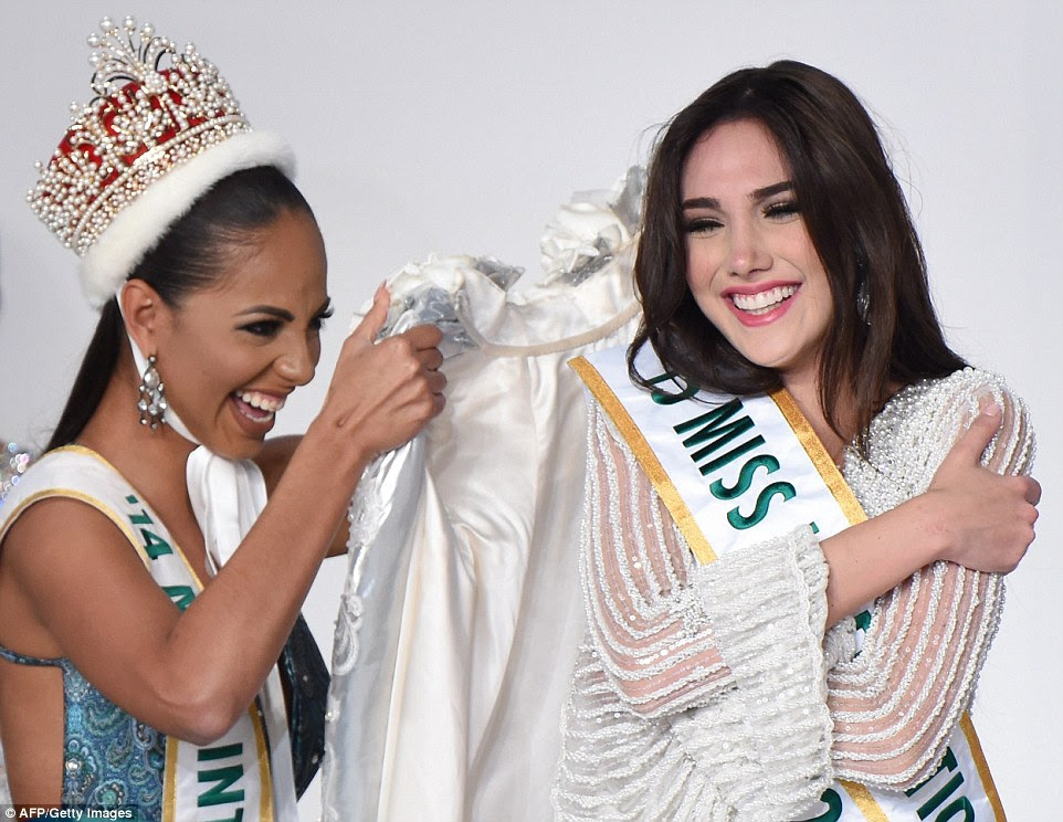 Wearing an elegant white dress glittering with sequins and pearls, Edymar smiled through happy tears and hugged herself as she was presented with her crowning glory