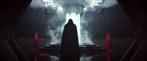 A mysterious figure enters a chamber flanked by the Emperor's Royal Guards in ROGUE ONE: A STAR WARS STORY.
