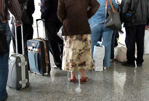 People waiting to check their luggage.