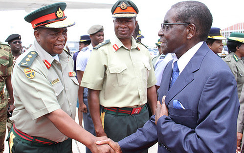 Republic of Zimbabwe President Robert Mugabe bids farewell to ZDF Commander Constantine Chiwenga before leaving for an African Union Summit in Addis Ababa on January 28, 2014. by Pan-African News Wire File Photos