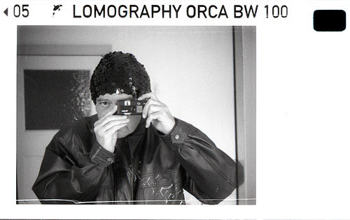reflected self-portrait with Rollei A110 camera and black sequined hat by pho-Tony