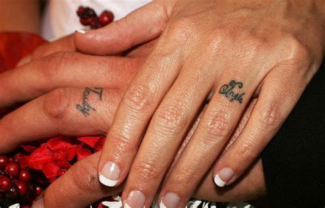 25 Slick Wedding Ring Tattoos   CreativeFan