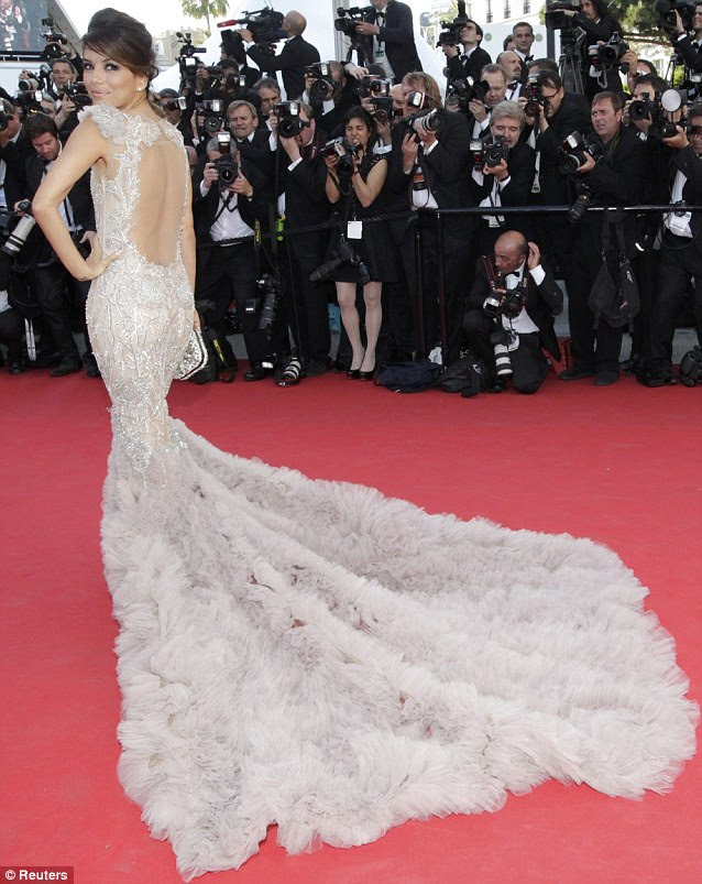 Caught the cameras' attention: Eva wore a stunning pale pink mermaid-style gown, fitted down to the knee when it flared into a long feathered train